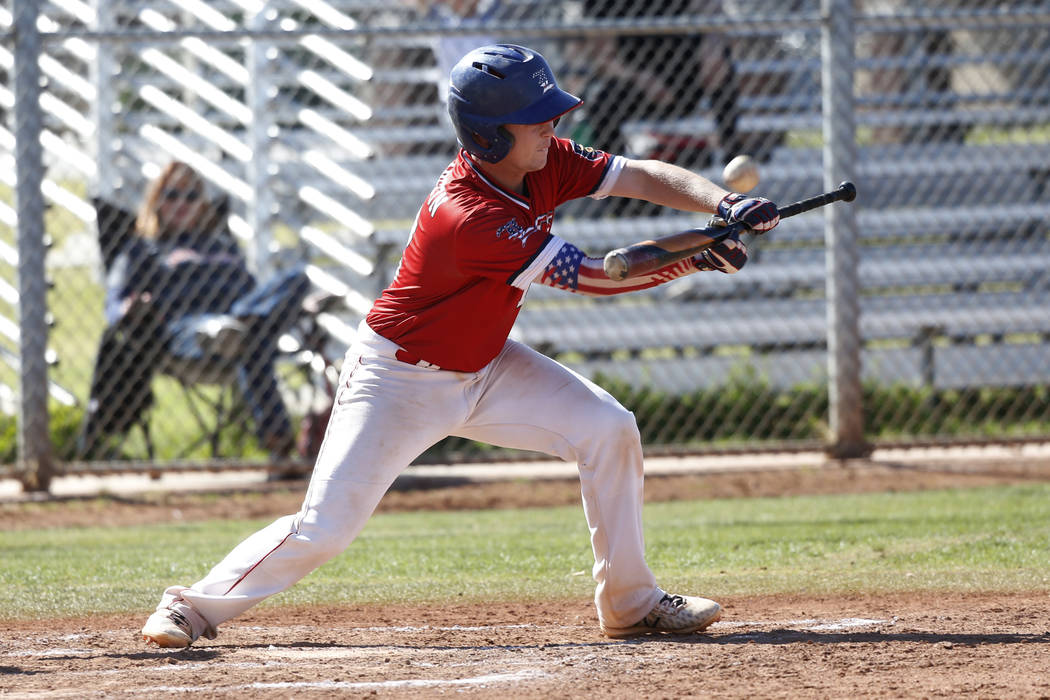 Liberty's Tyler Williamson (12) bunts the ball against Green Valley during the second inning of the baseball game at Liberty High School in Henderson, Friday, April 20, 2018. Green Valley won 7-6. ...
