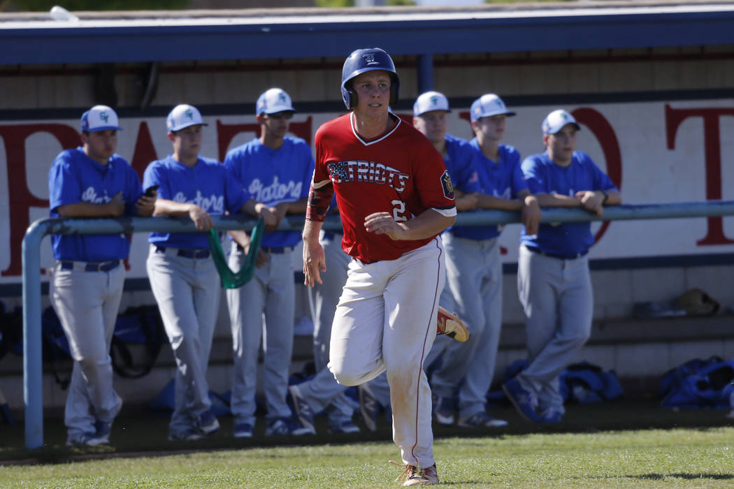 Liberty's Andrew Gallegos (21) runs for a score against Green Valley during the second inning of the baseball game at Liberty High School in Henderson, Friday, April 20, 2018. Green Valley won 7-6 ...