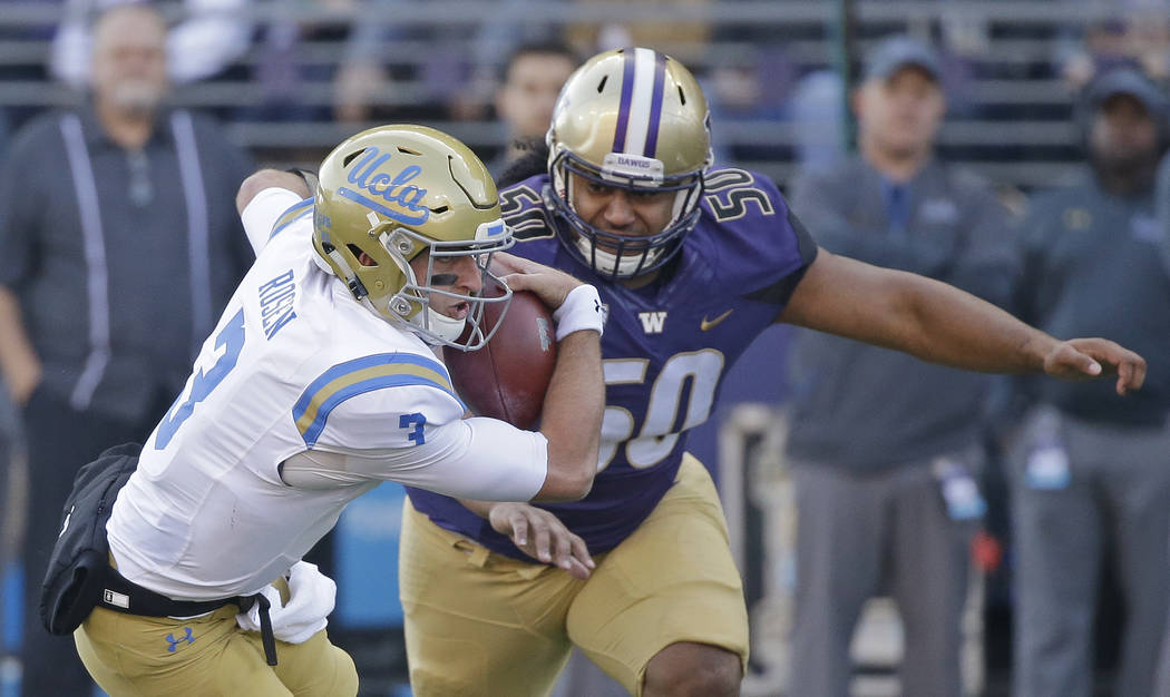 UCLA quarterback Josh Rosen is chased by Washington's Vita Vea in the first half of an NCAA college football game Saturday, Oct. 28, 2017, in Seattle. (AP Photo/Elaine Thompson)