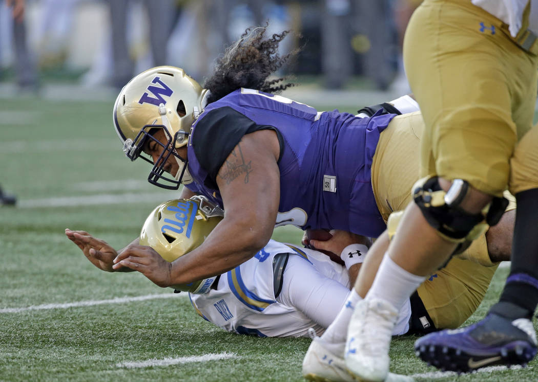 Washington's Vita Vea sacks UCLA quarterback Josh Rosen in the first half of an NCAA college football game Saturday, Oct. 28, 2017, in Seattle. (AP Photo/Elaine Thompson)