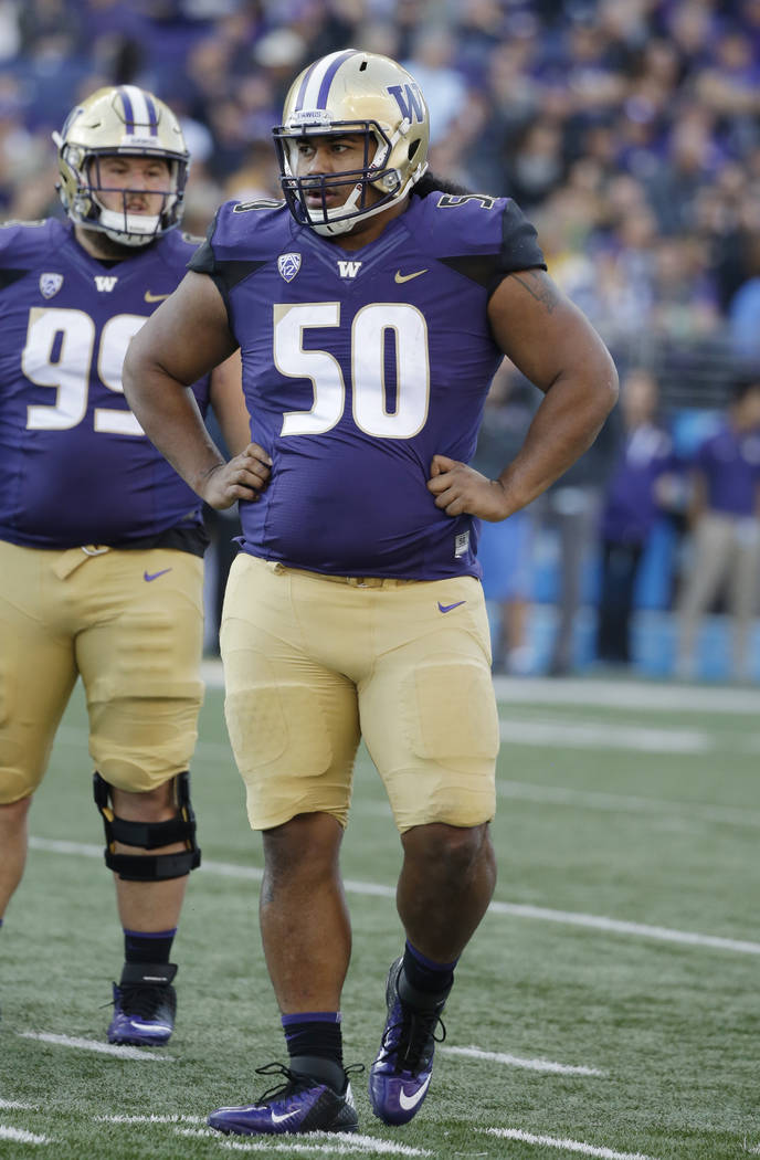 Washington's Vita Vea stands on the field against UCLA in an NCAA college football game Saturday, Oct. 28, 2017, in Seattle. (AP Photo/Elaine Thompson)