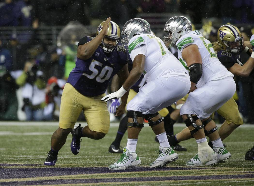 Washington defensive lineman Vita Vea, left, lines up against Oregon in the first half of an NCAA college football game, Saturday, Nov. 4, 2017, in Seattle. (AP Photo/Ted S. Warren)