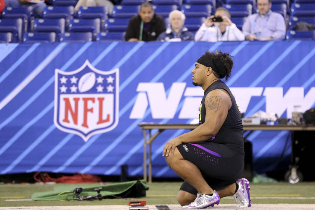 Washington defensive lineman Vita Vea is seen before the start in the 40-Yard Dash the 2018 NFL Scouting Combine on Sunday, March 4, 2018, in Indianapolis. (AP Photo/Gregory Payan)