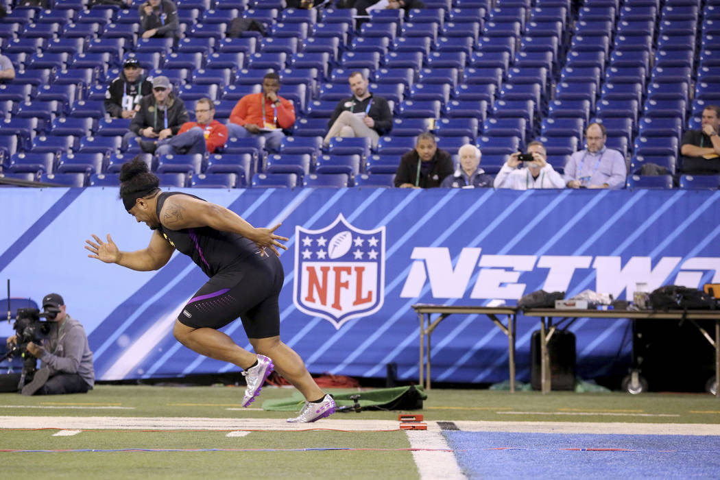 Washington defensive lineman Vita Vea comes out of the blocks in the 40-Yard Dash the 2018 NFL Scouting Combine on Sunday, March 4, 2018, in Indianapolis. (AP Photo/Gregory Payan)