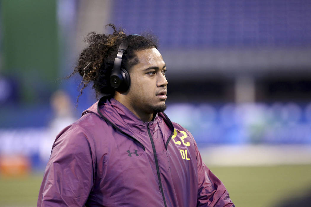 Washington defensive lineman Vita Vea is seen at the 2018 NFL Scouting Combine on Sunday, March 4, 2018, in Indianapolis. (AP Photo/Gregory Payan)