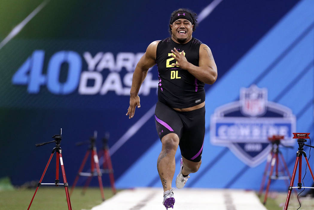 Washington defensive lineman Vita Vea runs the 40-yard dash at the NFL football scouting combine in Indianapolis, Sunday, March 4, 2018. (AP Photo/Michael Conroy)