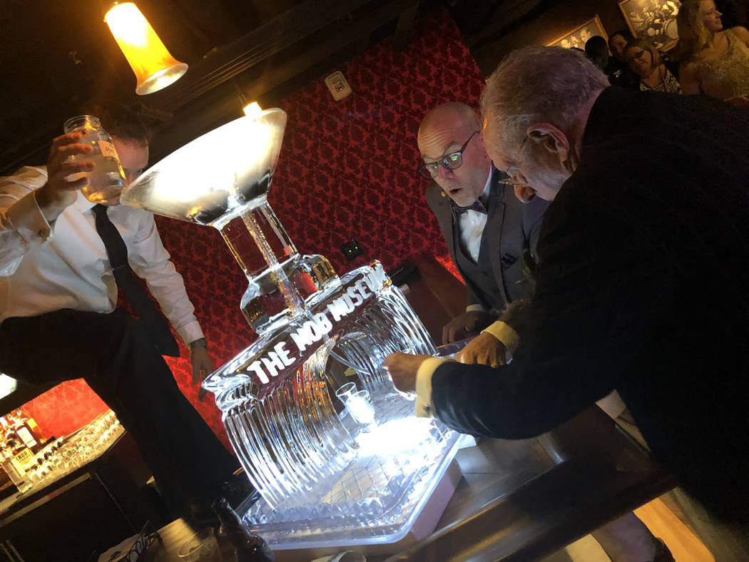 The Mob Museum President and CEO Jonathan Ullman and former Las Vegas Mayor Oscar Goodman pour a shot of moonshine at the grand opening of the Underground at The Mob Museum on Thursday, April 19, ...