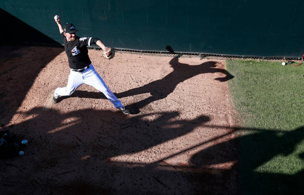 Chicago White Sox relief pitcher Danny Farquhar warms up in the bullpen during the sixth inning of the team's spring training baseball game against the Los Angeles Dodgers in Glendale, Ariz. on Ma ...