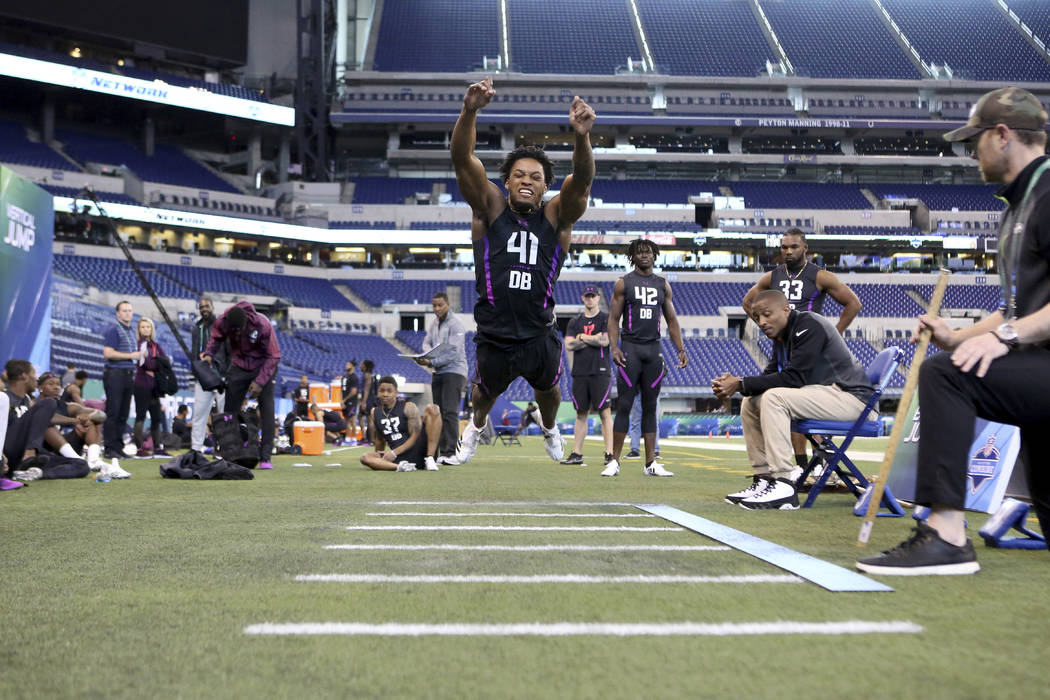 Ohio State defensive back Denzel Ward participates in the Broad Jump at the 2018 NFL Scouting Combine on Monday, March 5, 2018, in Indianapolis. (AP Photo/Gregory Payan)