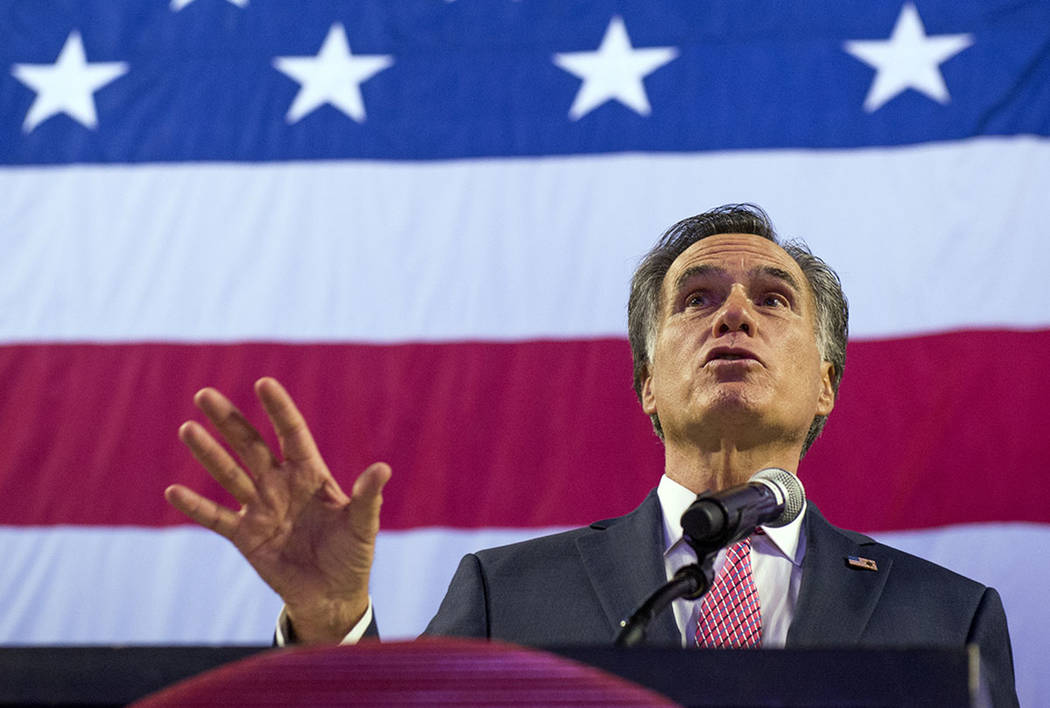 U. S. Senate candidate Mitt Romney delivers his speech to the delegates at the Utah Republican Nominating Convention Saturday, April 21, 2018, at the Maverik Center in West Valley City, Utah. (Lea ...