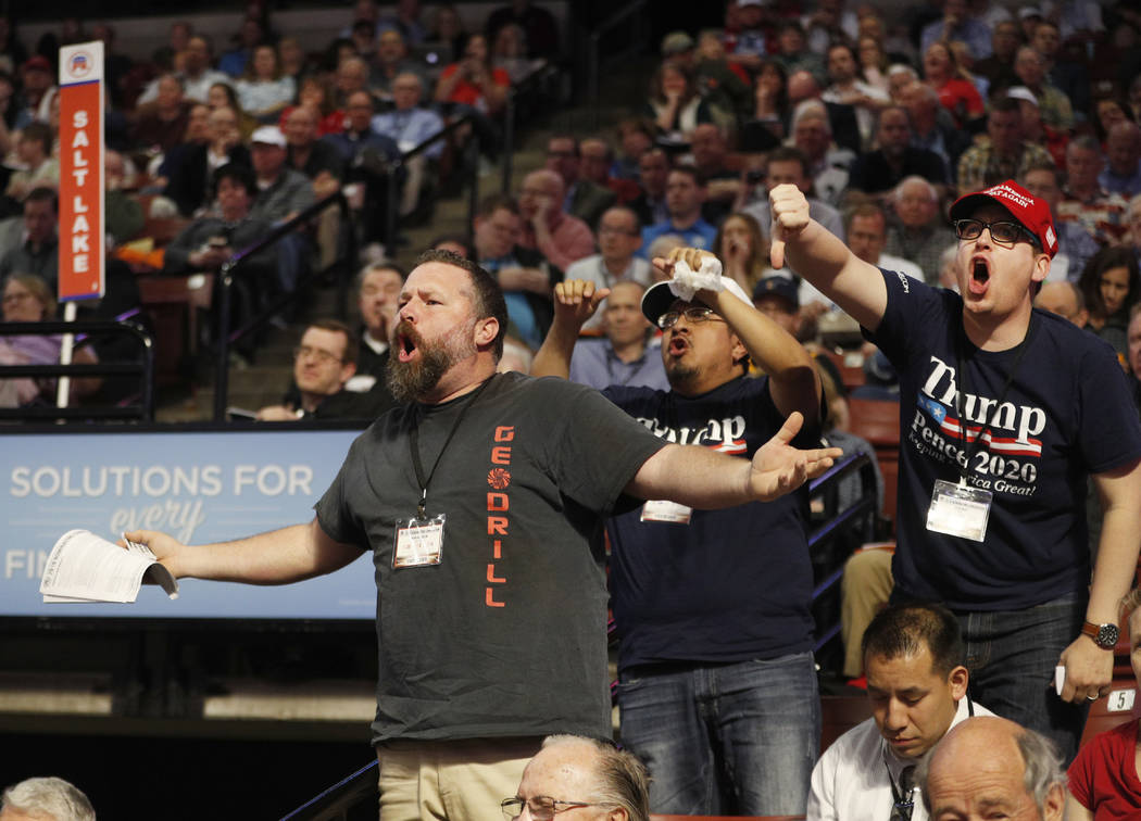 Delegates voice their disapproval during the Utah Republican 2018 nominating convention Saturday, April 21, 2018, in West Valley City, Utah. (AP Photo/George Frey)