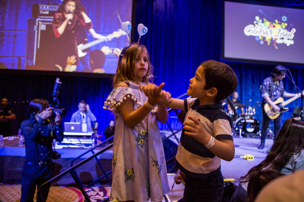 Ron, 5, and Yulie Harel, 7, play together during the Celebrate Israel Day Festival to celebrate Israel's 70th Independence Day at the Palazzo Ballroom in The Venetian on Sunday, April 22, 2018. ...