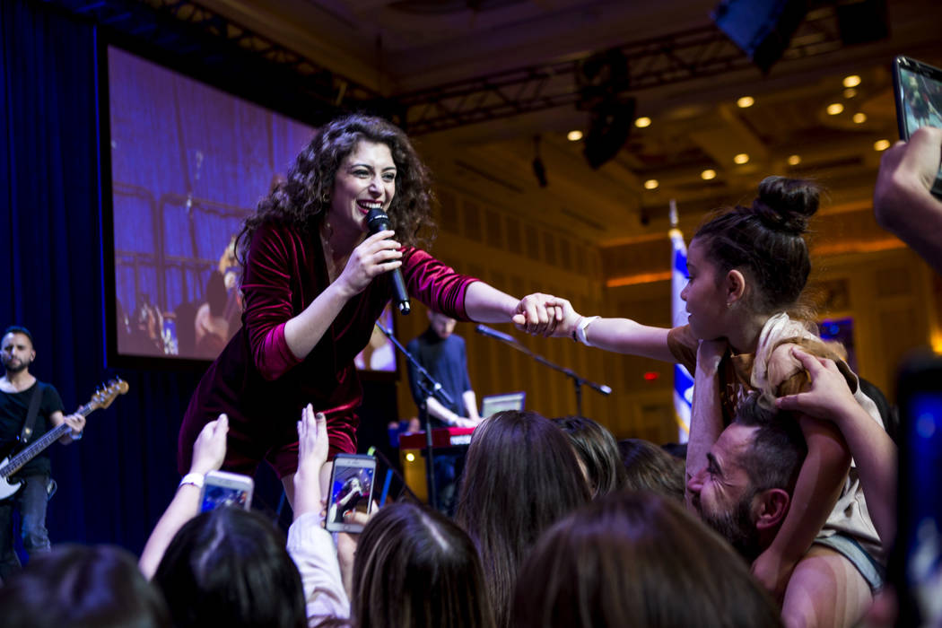 Israeli singer Roni Dalumi shares a moment with Amy Prives, 7, during the Celebrate Israel Day Festival to celebrate Israel's 70th Independence Day at the Palazzo Ballroom in The Venetian on Sunda ...