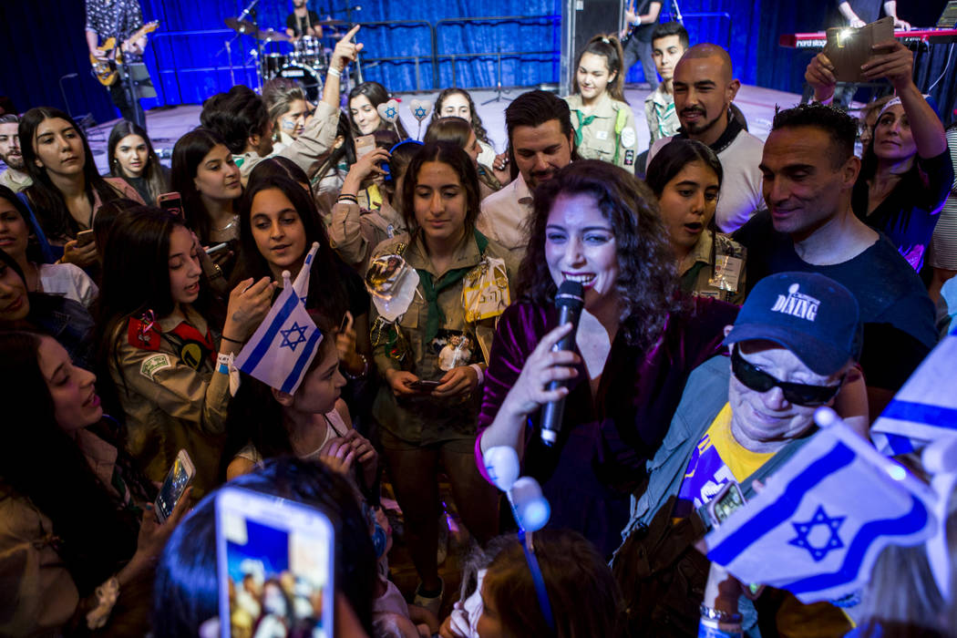 Israeli singer Roni Dalumi performs in the middle of the audience during the Celebrate Israel Day Festival to celebrate Israel's 70th Independence Day at the Palazzo Ballroom in The Venetian on Su ...