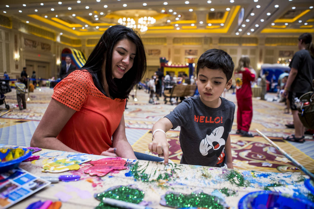 Carla Bracha helps her son Daniel with crafts during the Celebrate Israel Day Festival to celebrate Israel's 70th Independence Day at the Palazzo Ballroom in The Venetian on Sunday, April 22, 2018 ...