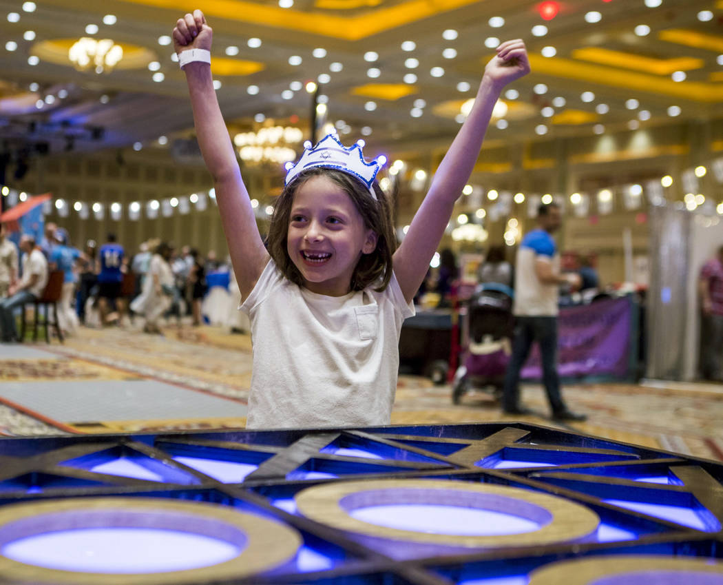 Rachel Cohen of Las Vegas, 7, celebrates after winning tic-tac-toe during the Celebrate Israel Day Festival to celebrate Israel's 70th Independence Day at the Palazzo Ballroom in The Venetian on S ...