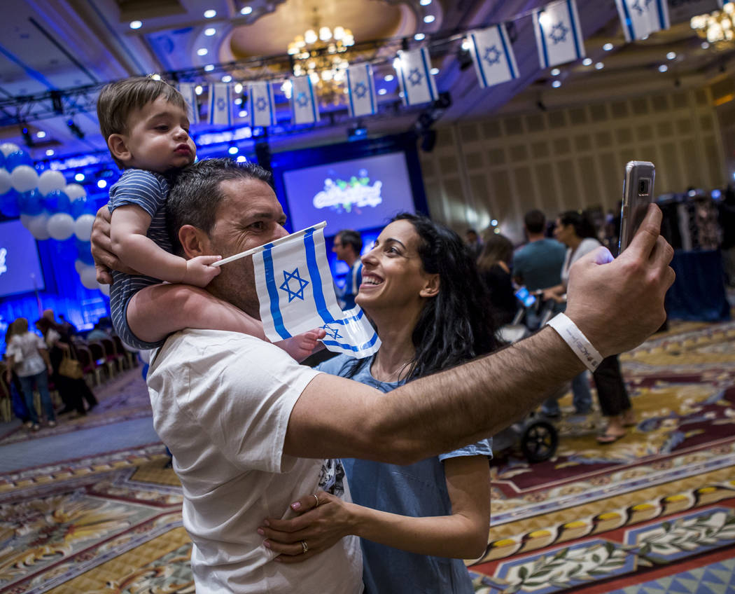 Sharon Ben Kessous takes a selfie with his wife Naama and son Michael, 11 months old, during the Celebrate Israel Day Festival to celebrate Israel's 70th Independence Day at the Palazzo Ballroom i ...