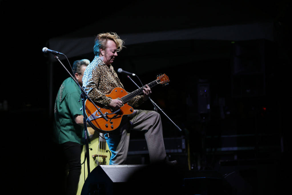 The Stray CatsÕ Brian Setzer performs to a crowd of thousands at the 21st Annual Viva Las Vegas Rockabilly Weekend car show at the Orleans hotel and casino on Saturday, April 21, 2018. Michae ...