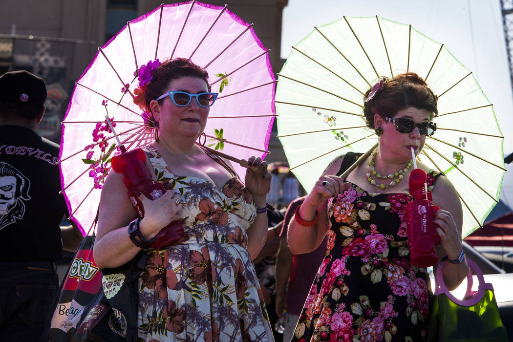 Carole Jensen, left, and Julie Murawski of Portland, Ore., don classic dresses and hold parasols at Viva Las Vegas at The Orleans on Saturday, April 21, 2018. Patrick Connolly Las Vegas Review-Jou ...