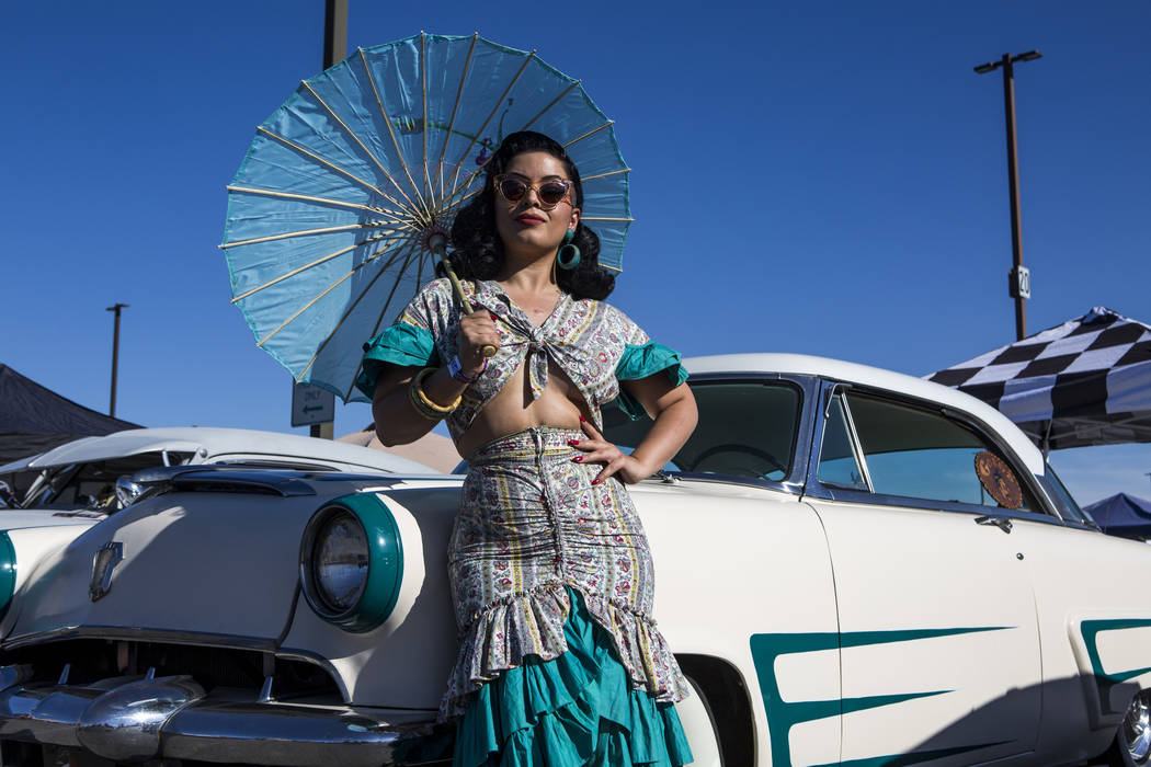 Jasmin Rodriguez of Las Vegas stands in front of a classic car at Viva Las Vegas at The Orleans on Saturday, April 21, 2018. Patrick Connolly Las Vegas Review-Journal @PConnPie