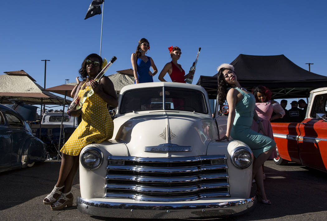 Women dressed in pin up attire, from left, Maria Bryant, Cherri Forever, Roxi Rocket, Sugar Moon and Susie Dahl pose with a classic Chevrolet pickup truck at Viva Las Vegas at The Orleans on Satur ...