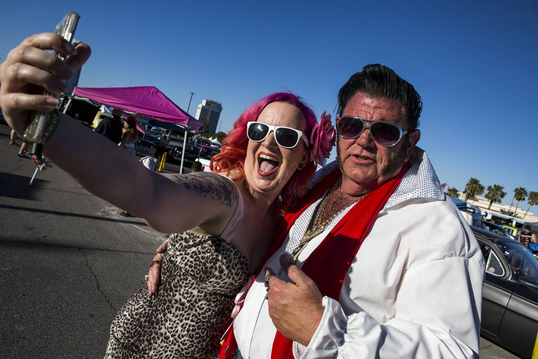 "Carrie McBride of Oklahoma City takes a selfie with Patrick ""P.J."" Anderson of Mesquite, who dressed as Elvis, at Viva Las Vegas at The Orleans on Saturday, April 21, 2018. Patrick Con ..."