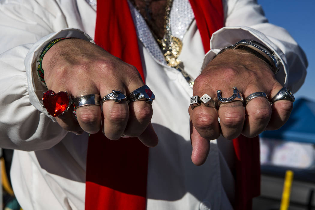 "Patrick ""P.J."" Anderson of Mesquite, dressed as Elvis, shows off his jewelry, replicas of rings that Elvis wore, at Viva Las Vegas at The Orleans on Saturday, April 21, 2018. Patrick C ..."