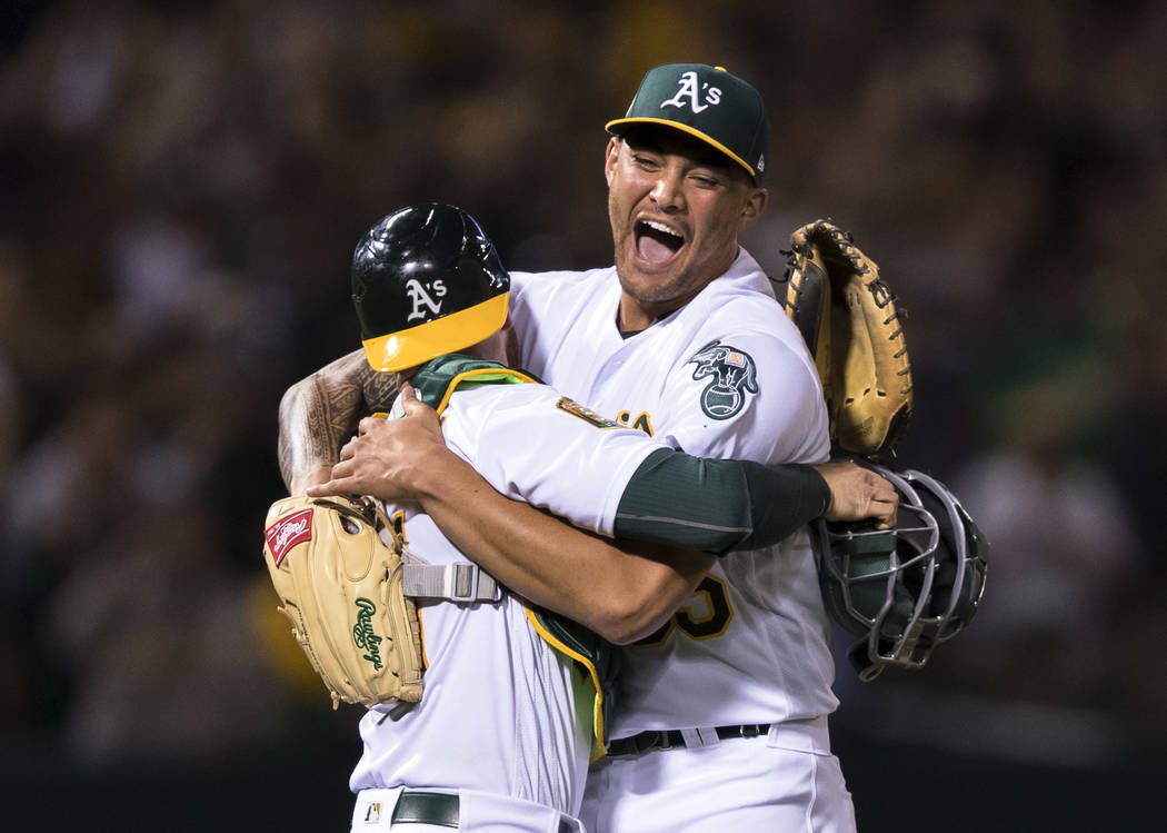 Oakland Athletics starting pitcher Sean Manaea, right, celebrates with catcher Jonathan Lucroy after pitching a no-hitter against the Boston Red Sox during a baseball game in Oakland, Calif., Satu ...