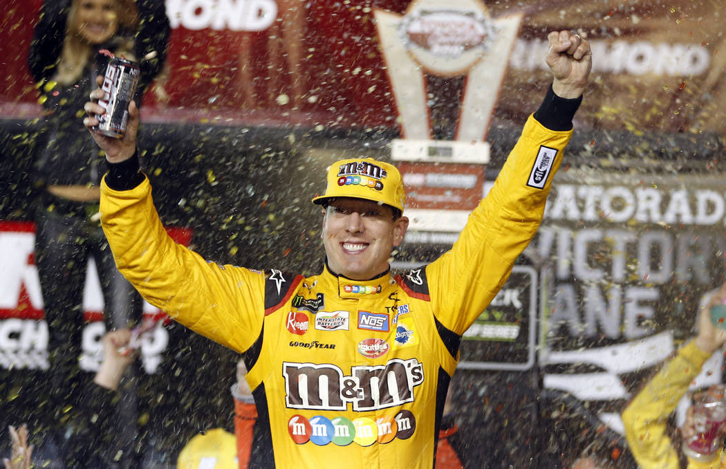 Kyle Busch celebrates in Victory Lane after winning the NASCAR Cup Series auto race at Richmond Raceway in Richmond, Va., Saturday, April 21, 2018. (AP Photo/Steve Helber)