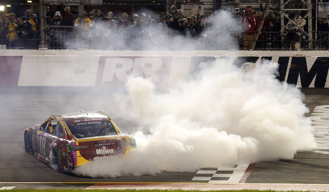 Kyle Busch does a burnout after winning the NASCAR Cup Series auto race at Richmond Raceway in Richmond, Va., Saturday, April 21, 2018. (AP Photo/Steve Helber)