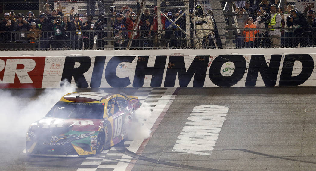 Kyle Busch does a burnout as he celebrates winning the NASCAR Cup Series auto race at Richmond Raceway in Richmond, Va., Saturday, April 21, 2018. (AP Photo/Steve Helber)