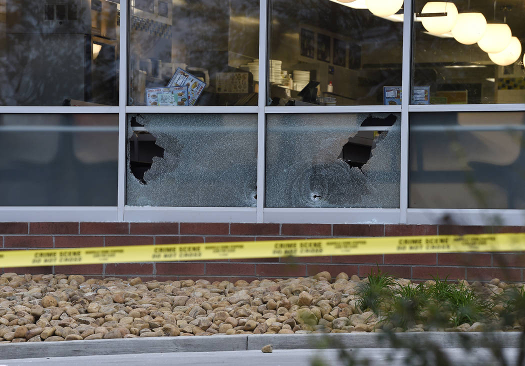 Bullet holes are seen at a Waffle House after a fatal shooting in the Antioch neighborhood of Nashville, Sunday, April 22, 2018. (George Walker IV/The Tennessean via AP)