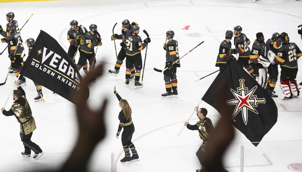 Golden Knights players celebrate after defeating the San Jose Sharks in an NHL hockey game at T-Mobile Arena in Las Vegas on Saturday, March 31, 2018. Chase Stevens Las Vegas Review-Journal @csste ...