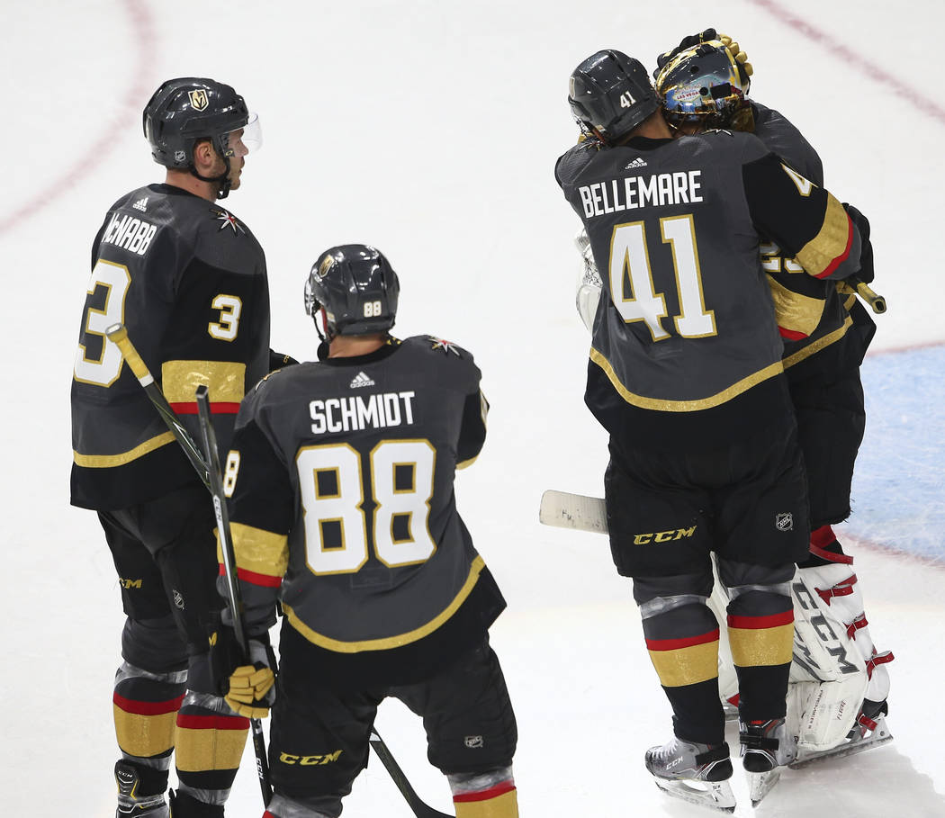 Golden Knights left wing Pierre-Edouard Bellemare (41) hugs Golden Knights goaltender Marc-Andre Fleury (29) at the end of an NHL hockey game against the San Jose Sharks at T-Mobile Arena in Las V ...