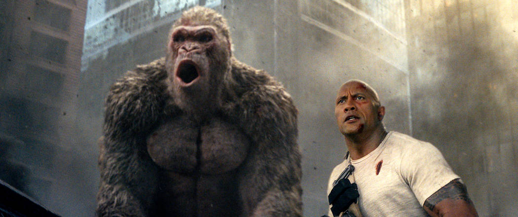 "This image released by Warner Bros. shows Dwayne Johnson in a scene from ""Rampage."" (Warner Bros. via AP)"