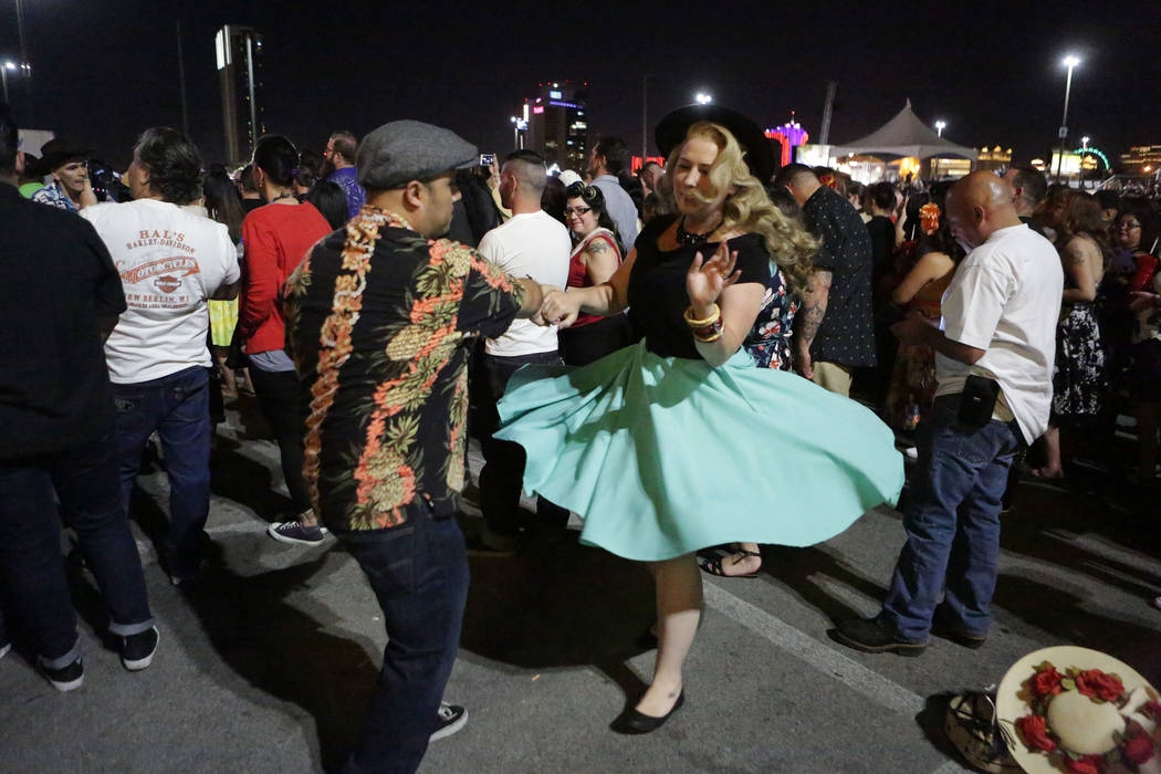 Diana and Eddie Manzanares of Los Angeles dance to the music of the Stray Cats at the 21st Annual Viva Las Vegas Rockabilly Weekend car show at the Orleans hotel and casino on Saturday, April 21, ...