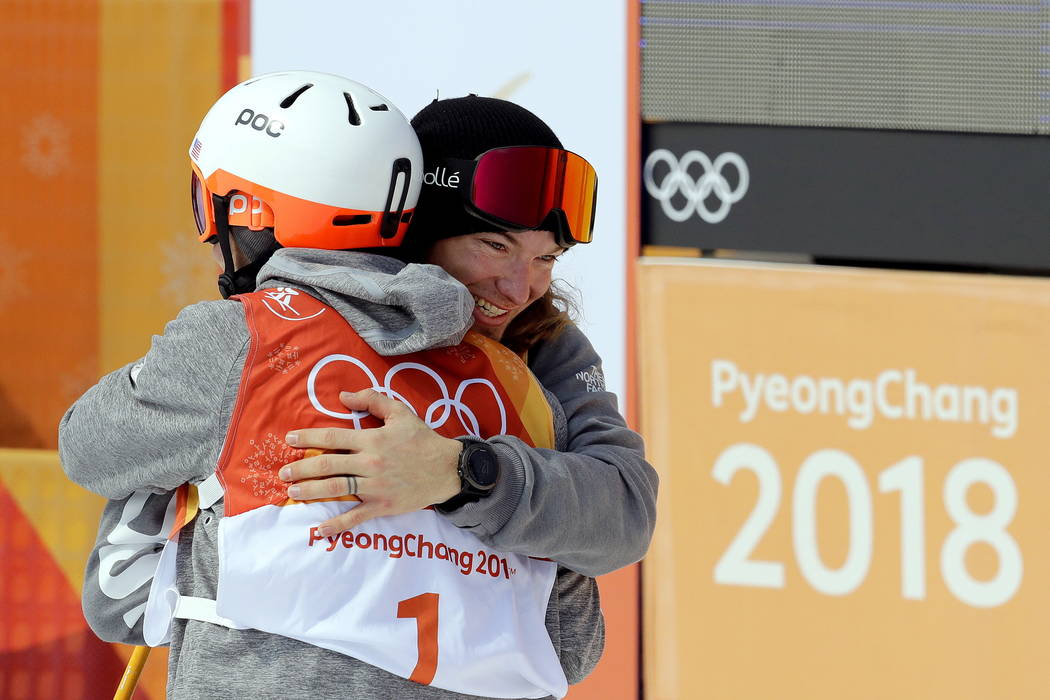 Gold medal winner David Wise, of the United States, right, embraces silver medal winner Alex Ferreira, of the United States, after the men's halfpipe final at Phoenix Snow Park at the 20 ...