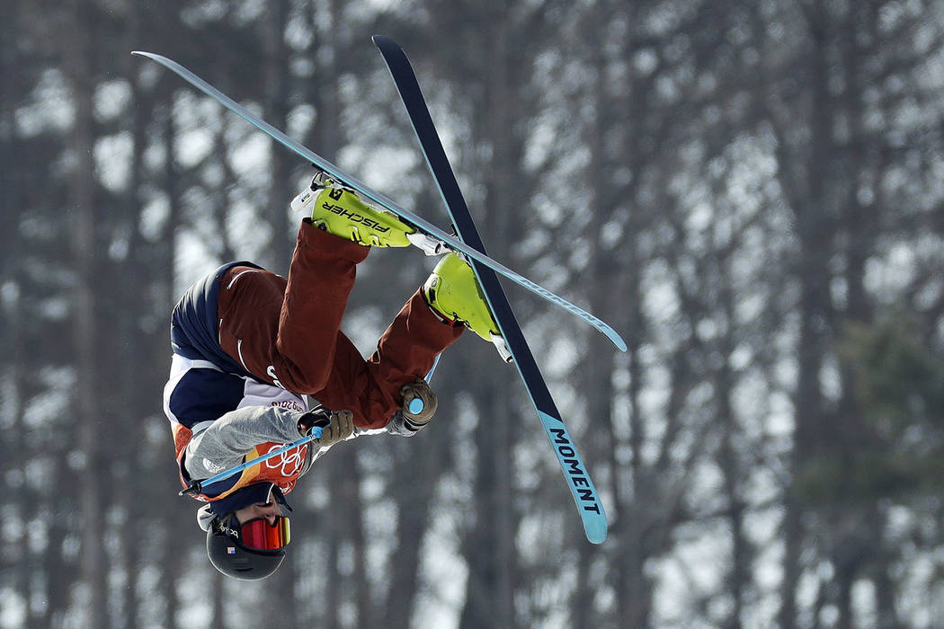 David Wise, of the United States, jumps during the men's halfpipe qualifying at Phoenix Snow Park at the 2018 Winter Olympics in Pyeongchang, South Korea, Tuesday, Feb. 20, 2018. (AP Photo/Ki ...
