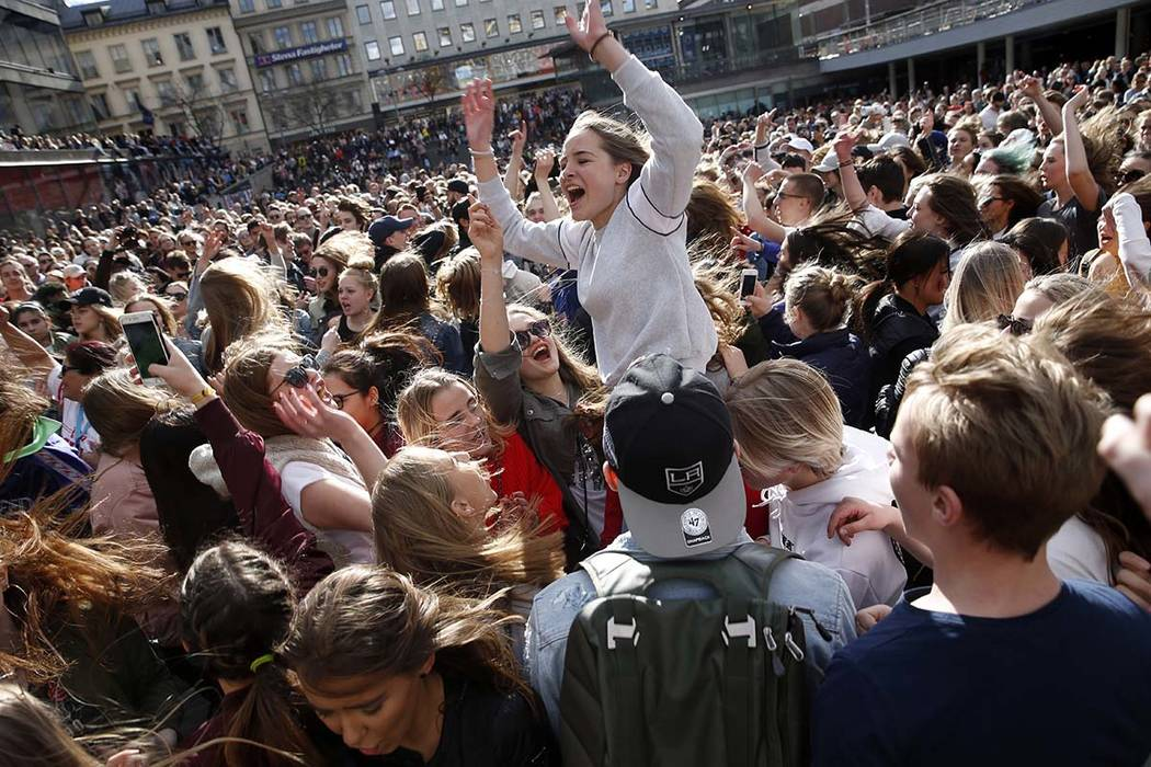 Fans of DJ Avicii gather at Sergels Torg following the news of his death, in central Stockholm, Sweden, Saturday, April 21, 2018. (Fredrik Persson/TT New Agency via AP)
