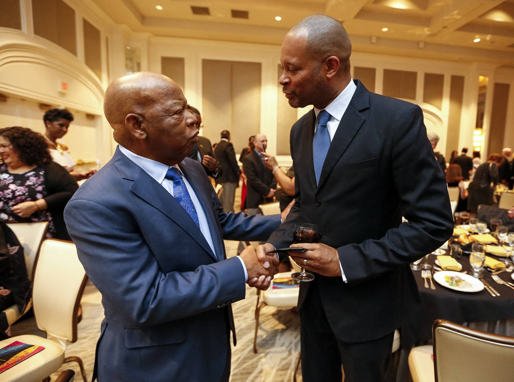 Rep. John Lewis, D-Ga.,left, greets Senate Majority Leader Aaron Ford, D-Las Vegas, during the annual Touro University Nevada gala and silent auction at the Four Seasons hotel in Las Vegas on Sund ...