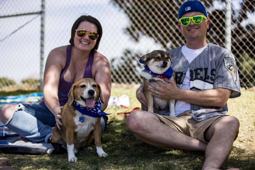 Allison and Bryan Cannon spend time with their dogs Copper, left, and Lloyd Christmas at Cashman Field in Las Vegas on Sunday, April 22, 2018. Patrick Connolly Las Vegas Review-Journal @PConnPie