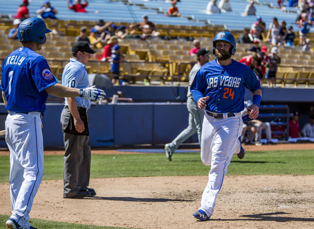 51s left fielder Bryce Brentz scores a run against the El Paso Chihuahuas during the seventh inning at Cashman Field in Las Vegas on Sunday, April 22, 2018. Patrick Connolly Las Vegas Review-Jou ...