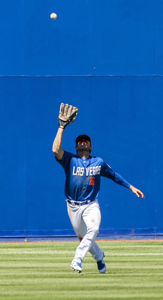 51s outfielder Matthew den Dekker looks to catch a pop fly while playing against the El Paso Chihuahuas in the seventh inning at Cashman Field in Las Vegas on Sunday, April 22, 2018. Patrick Con ...