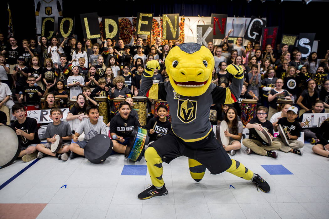 Vegas Golden Knights mascot Chance the Gila monster gets the crowd pumped up during a Golden Knights pep rally for fourth and fifth graders at John C. Vanderburg Elementary School in Henderson on ...