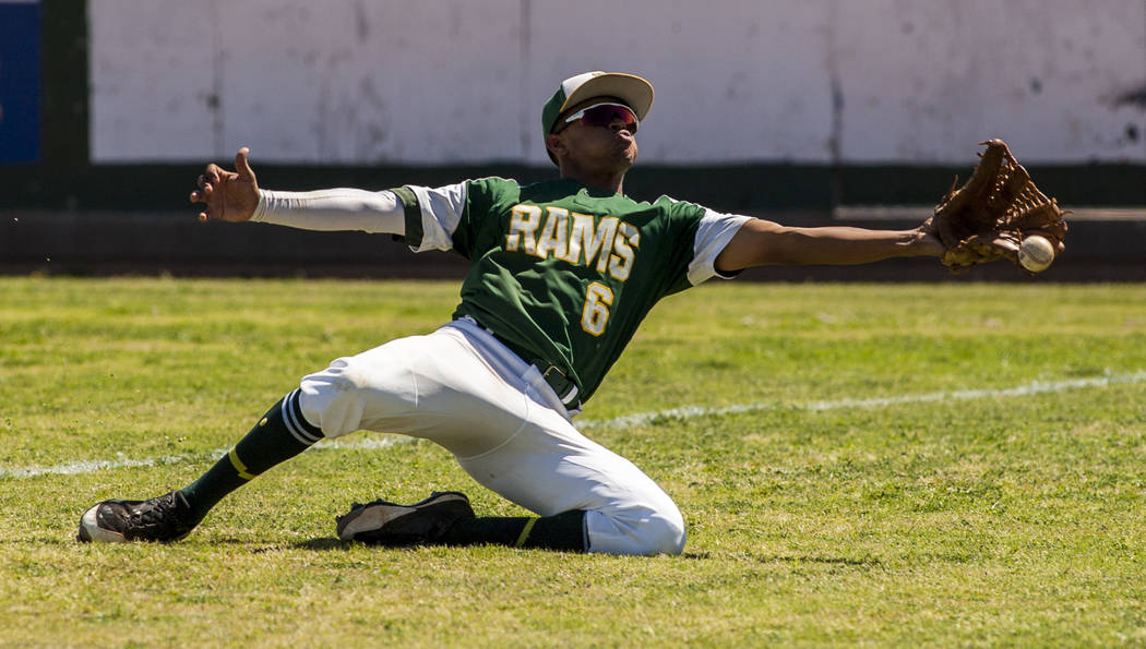 Rancho right fielder Kagen Kennedy misses a pop fly foul ball during the fourth inning while playing against Coronado at Rancho High School in Las Vegas on Saturday, April 21, 2018. Rancho won 5-1 ...