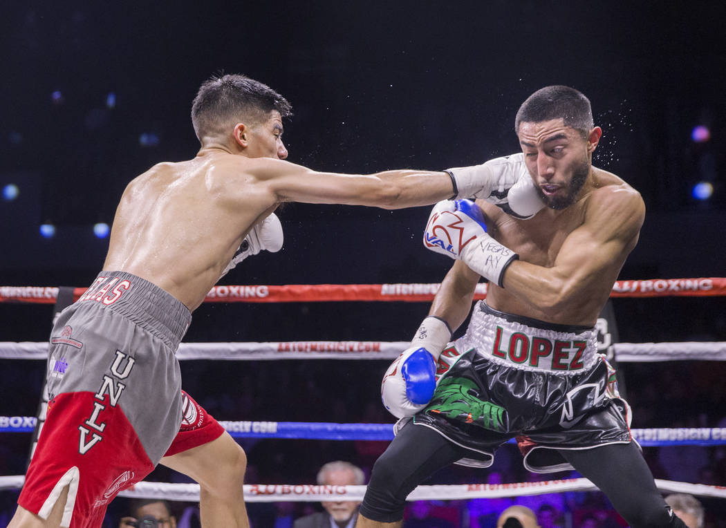 Max Ornelas, left, lands a right hook against Tony Lopez during their bantamweight boxing match on Friday, April 20, 2018, at Cox Pavilion, in Las Vegas. Ornelas defeated Lopez by unanimous decisi ...