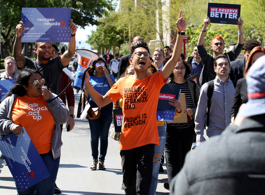 UNLV Political Science junior Karl Catarata, center, leads a student walkout Friday, April 20, 2018, on the 19th anniversary of the Columbine shooting. K.M. Cannon Las Vegas Review-Journal @KMCann ...