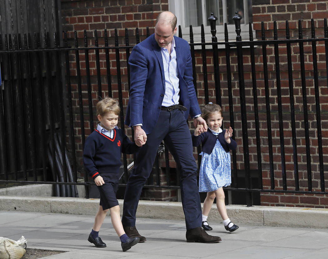 Britain's Prince William arrives with Prince George and Princess Charlotte back to the Lindo wing at St Mary's Hospital in London London, Monday, April 23, 2018. The Duchess of Cambridge gave birt ...