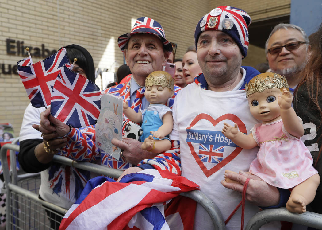 Royal fans John Loughrey, right, and Terry Hutt pose for a photo opposite the Lindo wing at St Mary's Hospital in London London, Monday, April 23, 2018. Kensington Palace says Prince William's wif ...