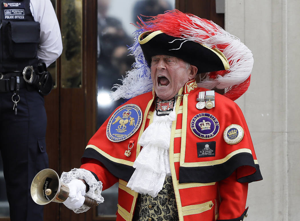Town Crier Tony Appleton announces that the Duchess of Cambridge has given birth to a baby boy outside the Lindo wing at St Mary's Hospital in London London, Monday, April 23, 2018. Kensington Pal ...